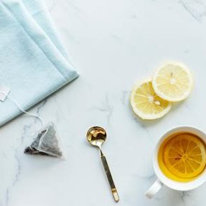 tea on table with spoon and lemon