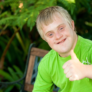 teen with disability thumbs up