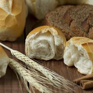 bread and wheat on table