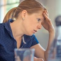 stressed woman hand on head