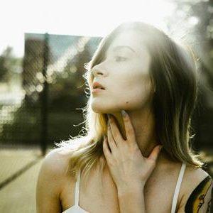 girl touching neck